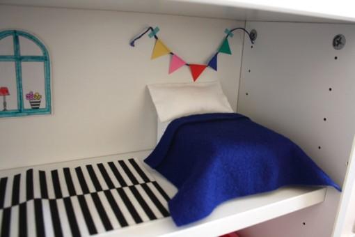 cama de casa para muñecas