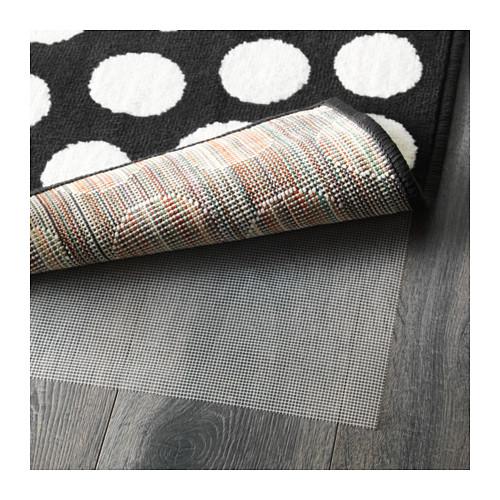 alfombra con protector antideslizante