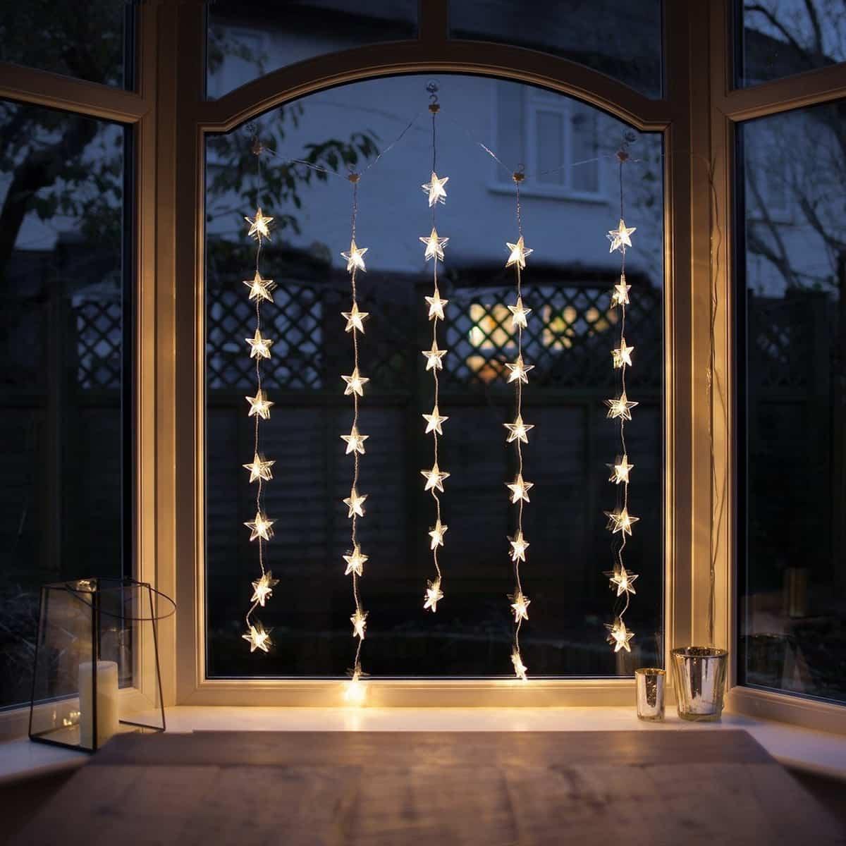 como iluminar la casa en navidad 11
